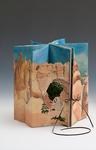 <p>The carousel book, &quot;Bryce Canyon&quot; consists of 3 layers of accordion fold papers, each slightly shorter than the last.&nbsp; The inner layer presents the sky; the middle one, the green growth in the canyon and the outside, the eroded sandstone hoodoos.</p> Click on image for more information.